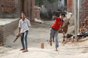 Muslim children play cricket in Nayabans village