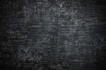 Intricate science and physic sketches on a blackboard