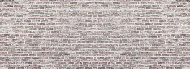 Photo sur Aluminium Brick wall Wide light red shabby brick wall texture. Old masonry panorama. Whitewashed rough brickwork panoramic vintage background