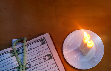 The Holy Quran and lights. Muslims holy book Koran. Open pages of the Holy Quran. Free space