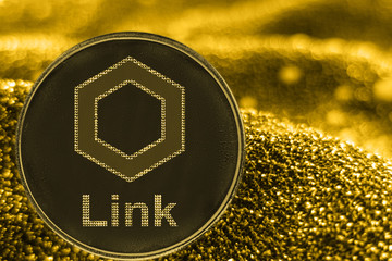 Coin cryptocurrency link chainlink token on golden background.
