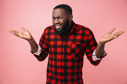 Portrait of a confused african man wearing plaid shirt