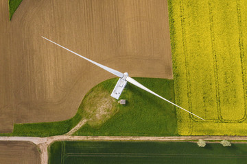 Wind turbines and agricultural fields on a summer day - Energy Production with clean and Renewable Energy - top view shot