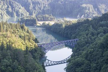 Fukushima, JAPAN - June 17 : The local train Tadami line and Tadami river on June 17 , 2017 in Fukushima , Japan. This train services in East Japan railway company's Tadami line.