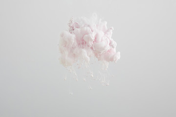 Wall Mural - Close up view of light pink paint splash isolated on grey
