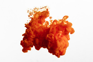 Wall Mural - Close up view of orange paint splash isolated on white