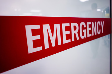 Red emergency room signs and patients who look scary