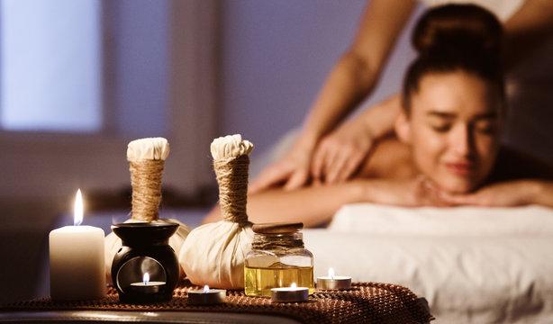 Aroma Spa. Woman Enjoying Back Massage In Luxury Spa