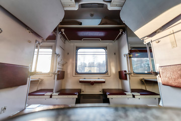 Empty passenger compartment in a moving train.
