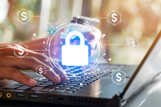 Financial security concept. Lock icon to protect the security of financial information in the use of computer for financial transactions.