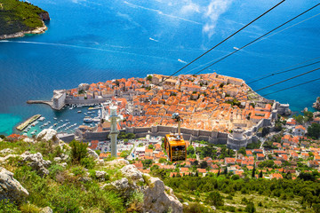 Wall Mural - Old town of Dubrovnik with cable car ascending Srt mountain, Dalmatia, Croatia