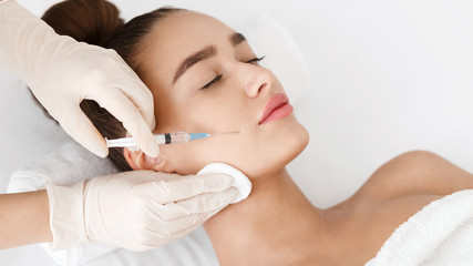Anti Wrinkle Surgery. Young Woman Receiving Injection