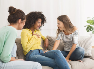 Friends having friendly talk, chatting at home