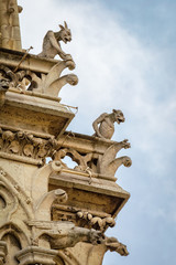 Exterior details of Notre Dame cathedral: Chimeras and Gargoyles