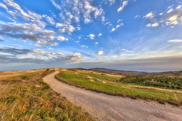 Wall Mural - Meandering road through Mediterranean landscape on the island of Cyprus