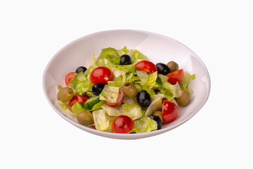fresh vegetable salad with tomatoes and black olives
