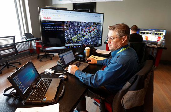 Dean Keck monitors computers during a NASA demonstration on the testing of its Unmanned Aircraft Systems Traffic Management (UTM) platform in Reno