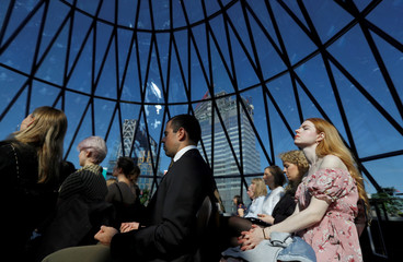 Participants meditate during an event in The Gherkin in London's financial district on World Meditation Day
