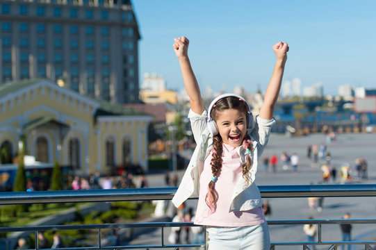 Girl little tourist kid explore city using audio guide application. Free style of travelling. Exciting journeys through cities and museums. Audio tour headphones gadget. City guide and audio tour