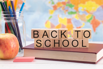 Back to School Background with School Supplies and a World Map