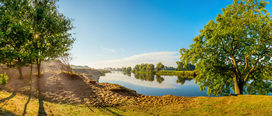 Wall Mural - Sunrise at the river in summer