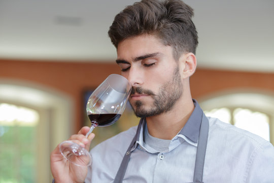 male sommelier is analyzing quality of drink