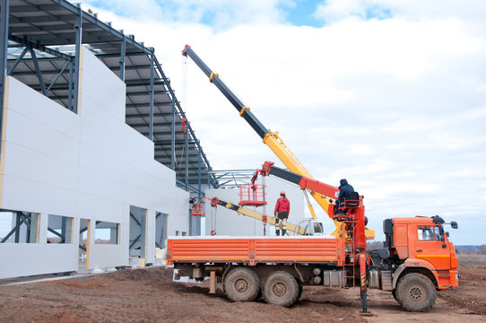 Installation of insulation panels on the construction of a new building. Warming of the building with modern insulation.