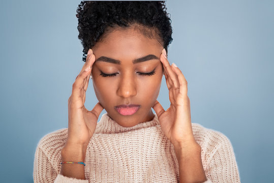 Black girl feeling pain isolated on gray background