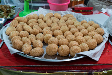 Ka Noom, a traditional Thai dessert fried in a pan during the Vegetarian Festival on Phuket Island in Thailand, Asia