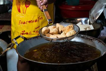 Fried Thai Tofu in a pan, Vegan street food at the Vegetarian Festival on Phuket Island in Thailand, Asia