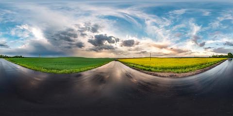 full seamless spherical hdri panorama 360 degrees angle view on wet asphalt road among canola...
