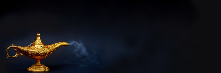 Magic lamp. A Vintage magical lamp and smoke coming out on the black background, website banner size.