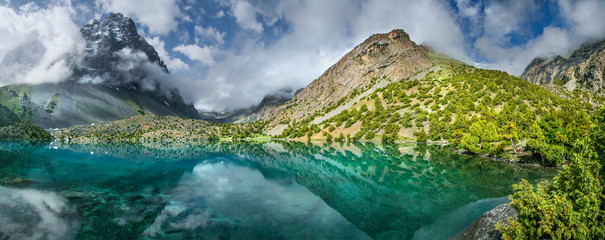 Tourism in Tajikistan, lake in the Fan Mountains. Scenic summer view, panorama landscape.
