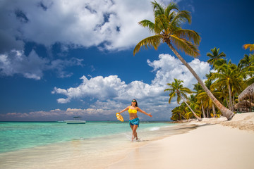 Island in the tropics. Happy girl enjoying tropical sandy beach, Saona island, Dominican Republic