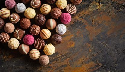 Fototapeta Flat lay display of luxury handmade chocolates obraz
