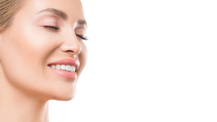 Close up view of a smiling woman with closed eyes over white background. Dental and skin care concept.