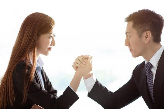 business woman VS business man arm wrestling