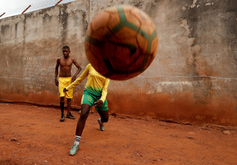 The Wider Image: Cameroonian girls defy prejudice to pursue soccer dreams