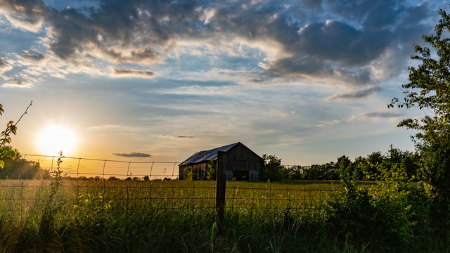 Scenic rural countryside with old barn in a field