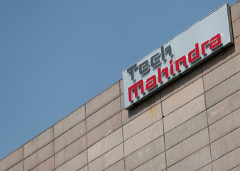 Tech Mahindra logo is seen on its office building in Noida