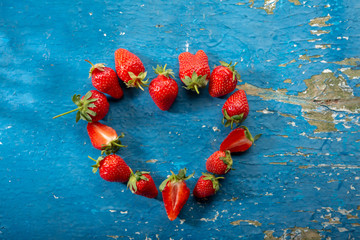 Red strawberry in heart shape