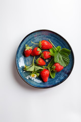 Organic berry on plate, food top
