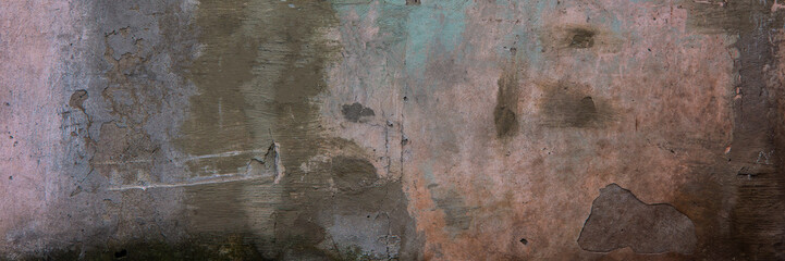 wall covered with old collapsing cement colored plaster.