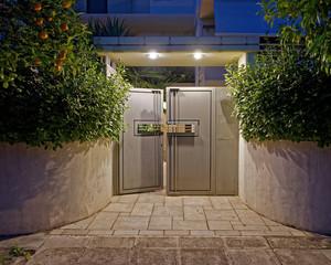 contemporary house entrance metallic grey door late in the evening