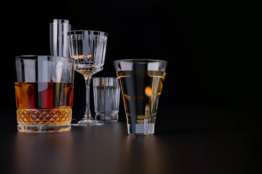 Strong alcoholic beverages, glasses and glasses, in the presence of whiskey, vodka, rum, tequila, brandy, cognac. on dark old background with selective focus