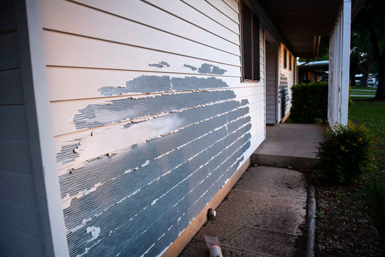 Siding peels from the exterior of a home in the Pershing Park Fort Hood Family Housing subdivision, in Fort Hood