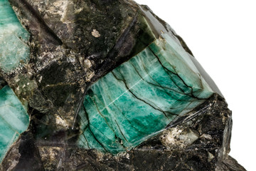 Macro emerald stone mineral in rock on white background