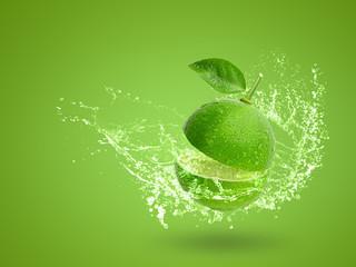 Fresh green lime isolated on white background Fototapete