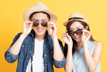 happy Asian couple in summer casual clothes and sunglasses