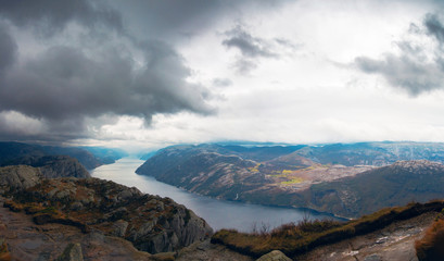 Panoramic view of foggy landscape of rocky mountains and Lysefjord in Preikestolen, Stavanger, Norway.